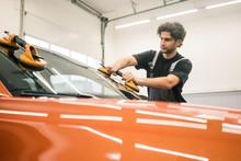 Car Mechanic In A Workshop Cha...