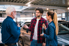 Couple Buying New Car At Car D...