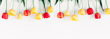 Beautiful Composition Of Spring Flowers. Yellow And Red Tulips Flowers On White Background. Valentine's Day, Easter, 8th March, Mother's Day. Flat Lay, Top View, Copy Space, Banner