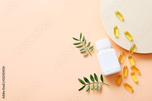 Fototapeta Fish oil vitamin capsules on light color background obraz