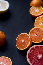 Various Sliced Citrus Fruits On A Dark Background