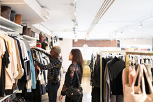 Two Women Looking At Clothes I...