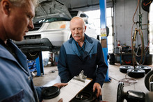 Two Mechanics Working In Autom...