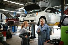 Female Car Mechanic Taking Bre...