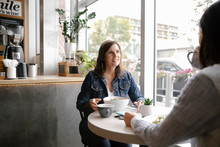 Two Women Enjoying Lunch In Cafe