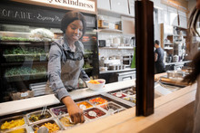 Waitress Serving Fresh Salad At Counter In Cafe