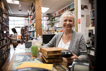Portrait Of Senior Woman Working In Independent Book Store