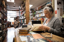 Senior Woman Working In Independent Book Store