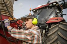 Teenage Boy Farmer With Ear Pr...