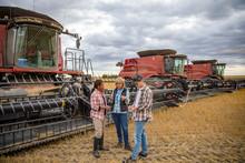 Farmers Talking Outside Combin...