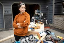 Portrait Of Happy Woman Doing Home Improvement Work