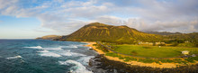 Panorama Of Koko Head Crater Taken From A Drone In Hawaii With Both A Rocky And A Sandy Beach With The Incoming Surf From The Pacific Ocean In Morning Light.