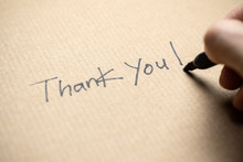 Hand Writing Thank You Note On...