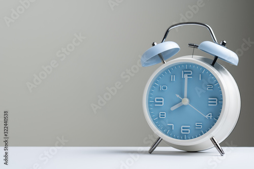 Blue color old fashioned bell alarm clock showing 8 o'clock isolated on white ba Canvas Print