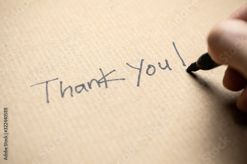 Photo Hand writing thank you note on brown color paper