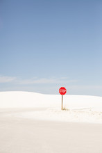 White Sand Desert With Stop Sign