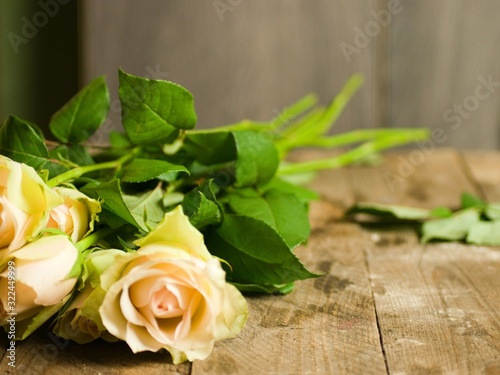 Bouquet of beautiful yellow roses on a wooden table