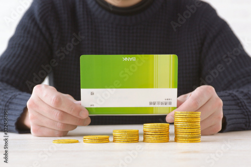 Photo 資産の増加イメージ―模造品の通帳とコイン