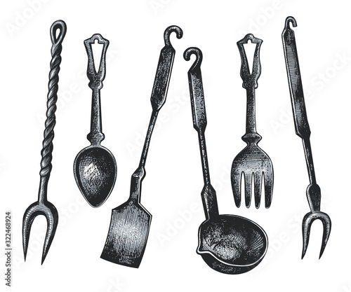Obraz na plátne .Set of vintage cutlery and kitchen utensils.Spoon, fork,ladle, paddle and meat