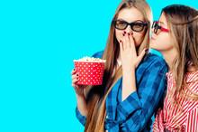 Two Girlfriends Eat Popcorn In...