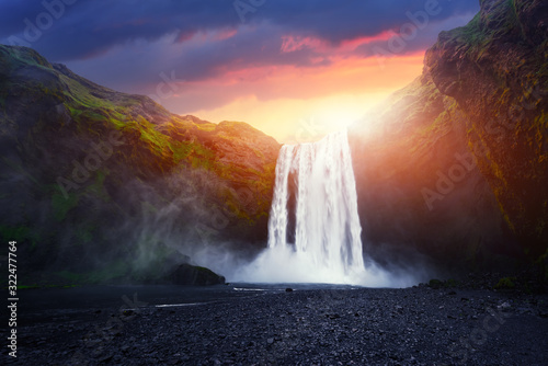 Incredible landscape with Skogafoss waterfall and unreal sunset sky. Iceland, Europe - 322477764