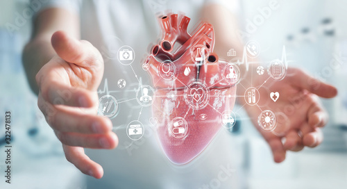 Photo Man using digital x-ray of human heart holographic scan projection 3D rendering