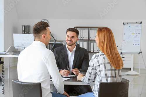 Fototapeta Bank manager working with clients in office obraz