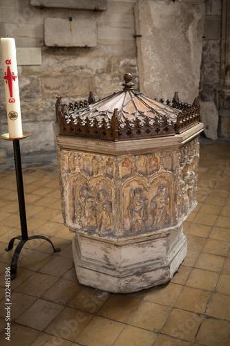Fotografie, Tablou Stone baptismal font in  Basilique Saint-Urbain, 13th century gothic church in T