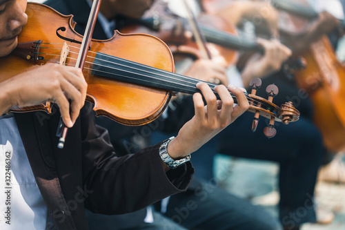 Fotografiet Symphony orchestra on white background, hands playing violin