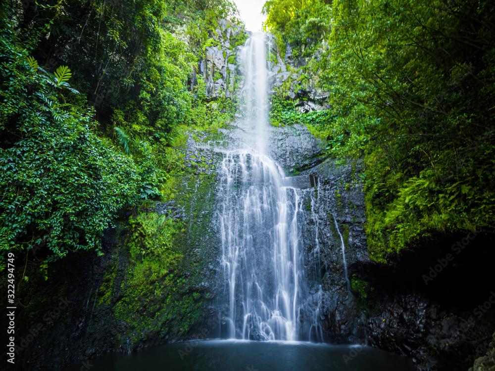 Fototapeta Maui, Hawaii Hana Highway - Wailua Falls, near Lihue, Kauai. Road to Hana connects Kahului to the town of Hana Over 59 bridges, 620 curves, tropical rainforest