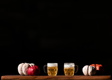 Beer & Pumpkins On Dark Background