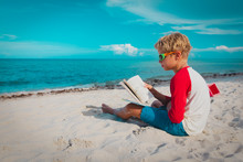 Boy Reading Book At Sand Beach, Kid Learning On Vacation