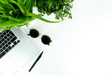 Flat Lay With Notebook, Sunglasses, Plants, Pencil And Camera