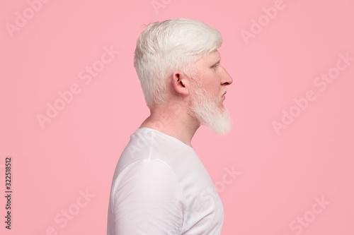 Bearded albino man in white t-shirt Wallpaper Mural