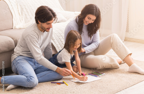 Millennial Parents Drawing With Their Little Daughter On Floor At Home Canvas Print