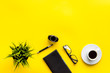 canvas print picture - Journalist's desk. Notebook, pen, crumpled paper on yellow background top-down frame copy space