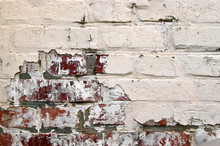 Old Grunge Red Brick With Peeled White Plaster.