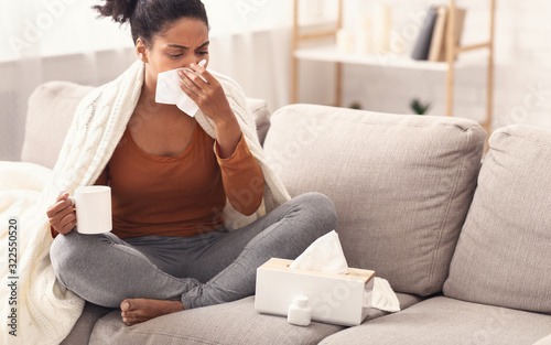 Fototapety, obrazy: African American Lady Blowing Nose In Tissue Sitting Indoor