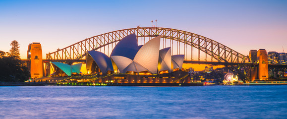 AUSTRALIA - AUGUST 12, 2019: Cityscape panorama view of Opera house with blue sky. The most famous tourist attraction in Sydney city, Australia.