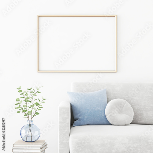 Fototapeta Poster mockup with horizontal frame hanging on the wall in living room interior with sofa, blue pillow and green branches in vase. 3D rendering, illustration. obraz