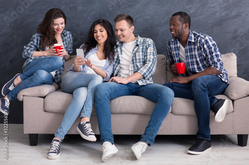 Fotografie, Tablou Excited multiethnic friends spending time together at home