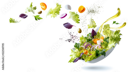 Flying ingredients salad isolated on a white background Canvas Print