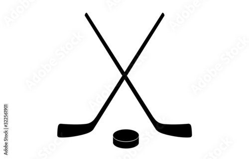 Fotografia A vector illustration of two crossed hockey sticks and a puck