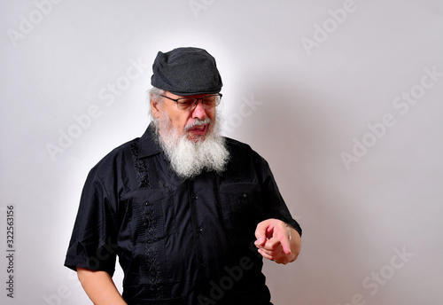 Fotografering Old man is repulsed by what he finds