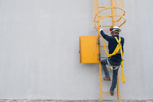 Technician Wear Seat Belts Safety Harness Going Up The Stairs Fixed Ladder Working On A High Ground In Industrial Plants Prevent Fall From A Height Wear Protective Equipment With Space To Enter Text