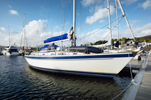 Yachts And Boats Moored To A P...
