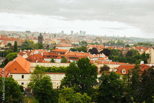 Fototapeta Prague. 05.10.2019: Orange colored roof tops of Prague old town buildings and baroque style houses viewed from top of old town hall tower, Prague, Czech Republic. Panorama. obraz na płótnie