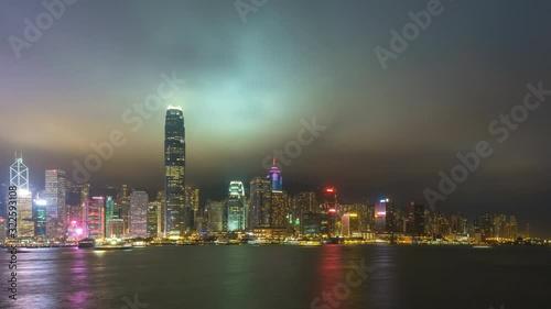 Fototapeta Hong Kong time lapse 4K, city skyline day to night timelapse at Victoria Bay Hon