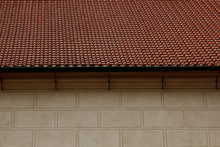 Prague. 05.10.2019: Low Light Detail Of Patina Red Roof Top. Prague Lesser Town Typical Roofing Material. Old Roofing Of Clay Tiles. Various Orange Shades And Stains.