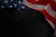 Close up of waving national usa american flag on black background with copy space.